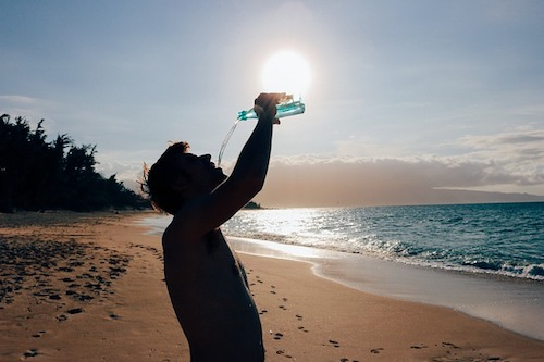 drinking water on a beach