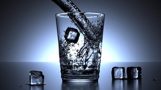 water and ice cubes in glass
